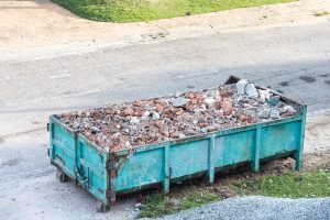 Garbage roro dumpter bin collects rubbish at construction site